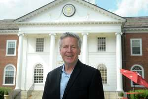 Jim Simon poses in front of Stratford Town Hall, in Stratford, Conn. Aug. 12, 2020.