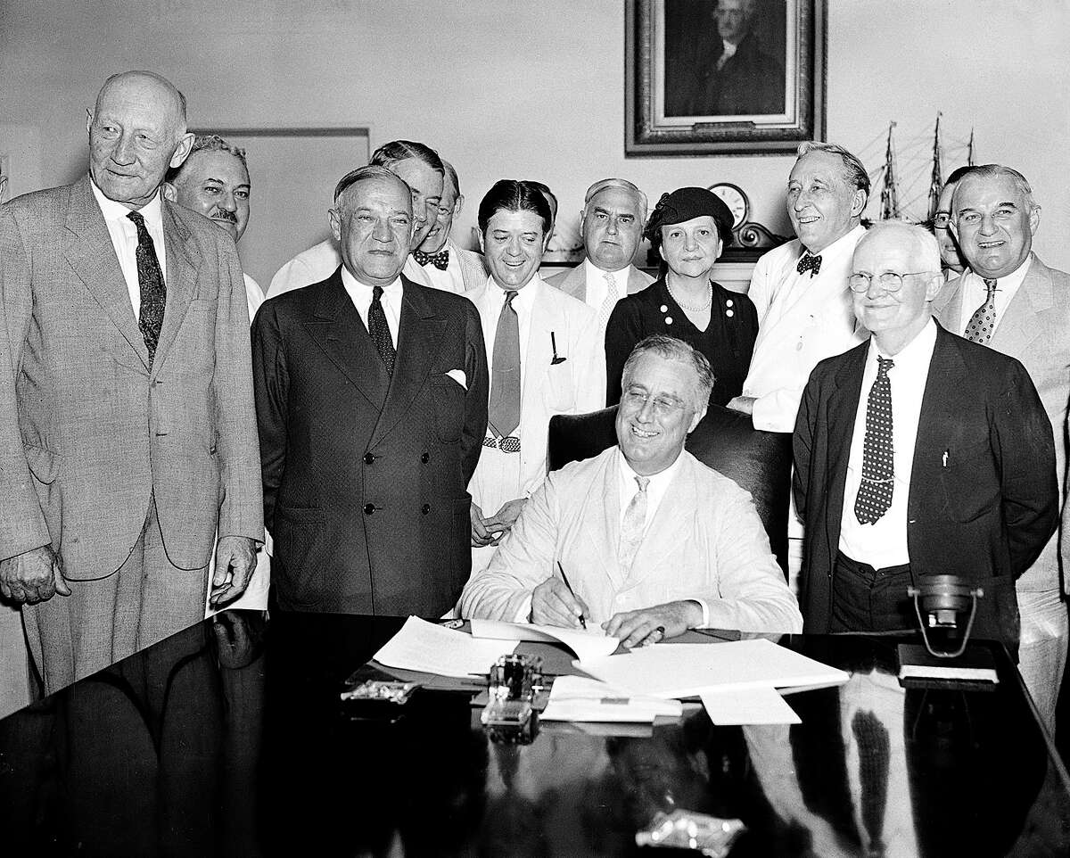 President Franklin Roosevelt signs the Social Security Bill in Washington on Aug. 14, 1935. In the 85 years since, Social Security has proven to be immensely popular with Americans, but the pandemic threatens its long-term future to deliver full benefits.