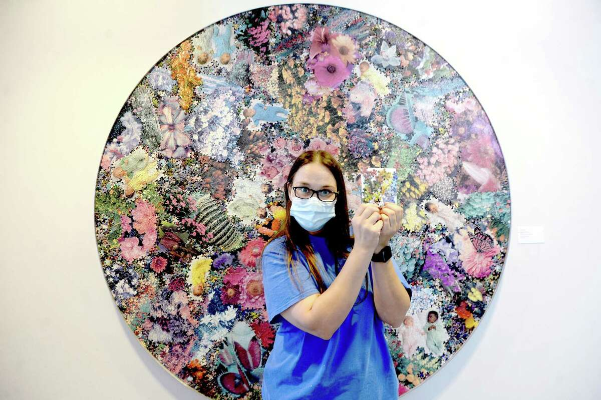Art Museum of Southeast Texas staffer Christle Feagin shows a puzzle craft project inspired by artist Al Souza's work, which is among the projects they will hand out this Saturday during a