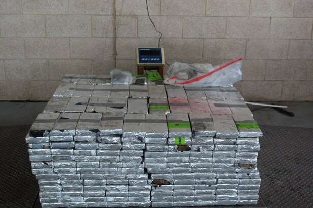 One man is in custody after U.S. Customs and Border Protection agents found nearly $20 million worth of methamphetamine hidden in a produce trailer at a South Texas port.