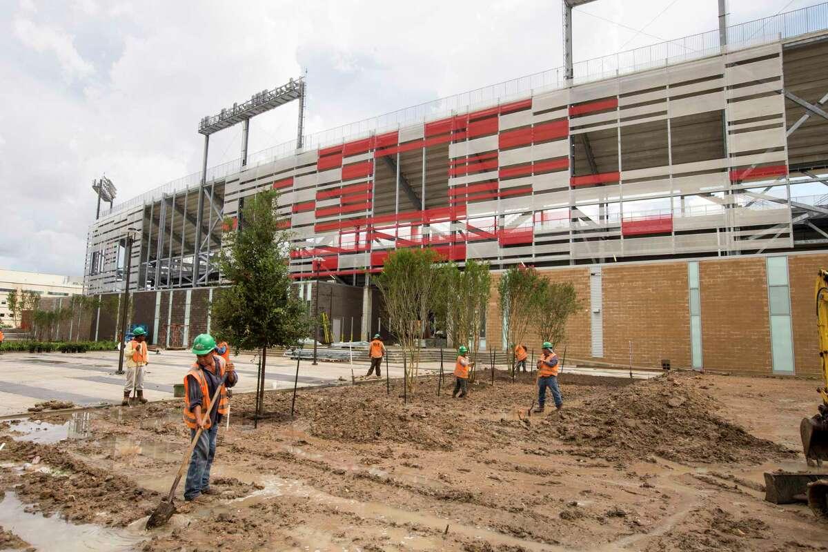 Workers prepare the landscaping outside TDECU Stadium on the University of Houston Campus Tuesday, Aug. 5, 2014, in Houston. TDECU Stadium is scheduled to open on August 29, went UH plays the University of Texas-San Antonio. ( Brett Coomer / Houston Chronicle )