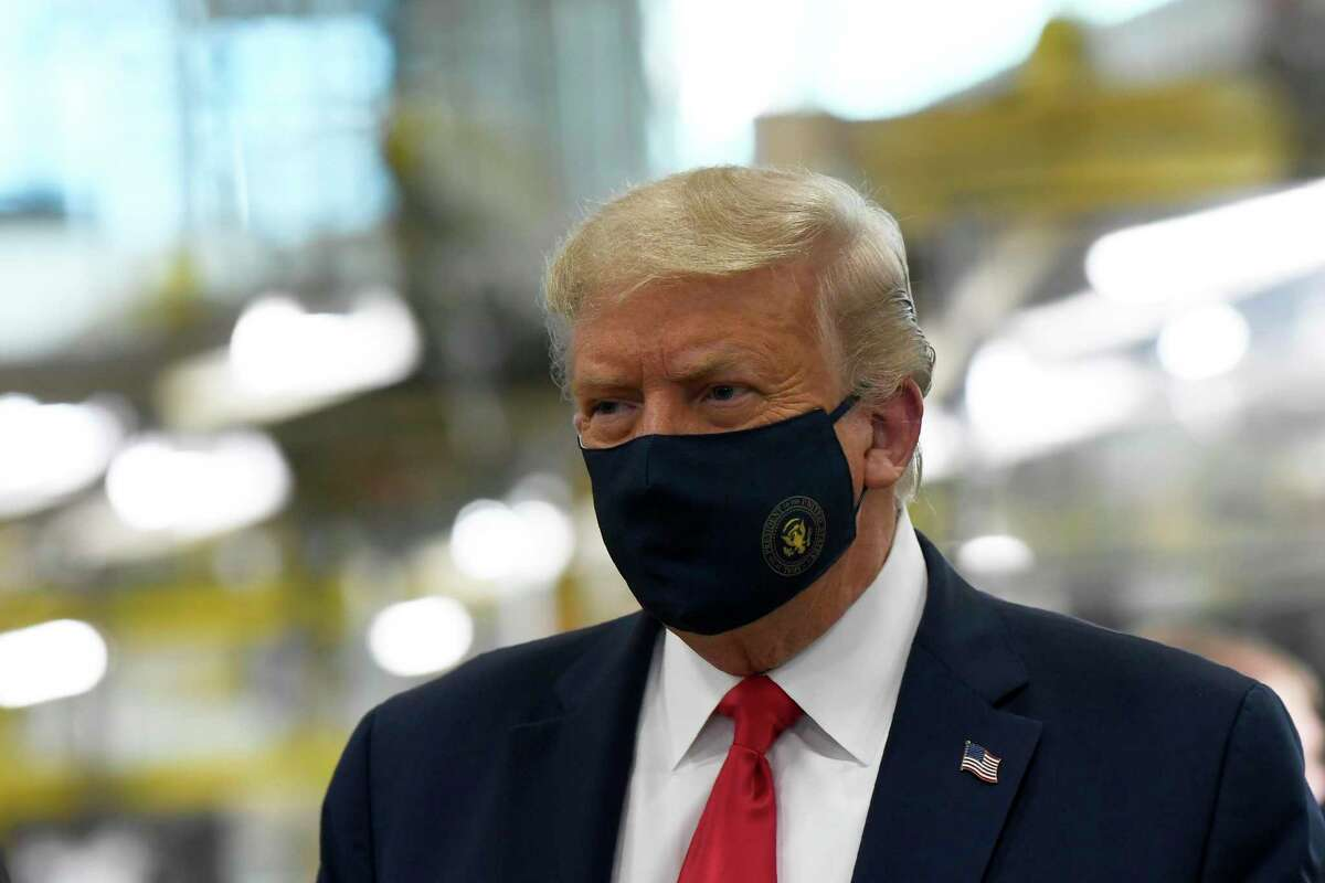 President Donald Trump wears a mask as he tours the Whirlpool Corporation facility in Clyde, Ohio, Thursday, Aug. 6, 2020.