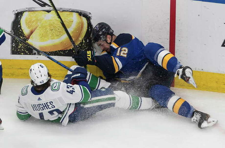 The Canucks' Quinn Hughes (left) and the Blues' Zach Sanford battle for the puck during the second period in Game 1 of a NHL Stanley Cup first-round playoff series Wednesday night in Edmonton, Alberta. Photo: Associated Press