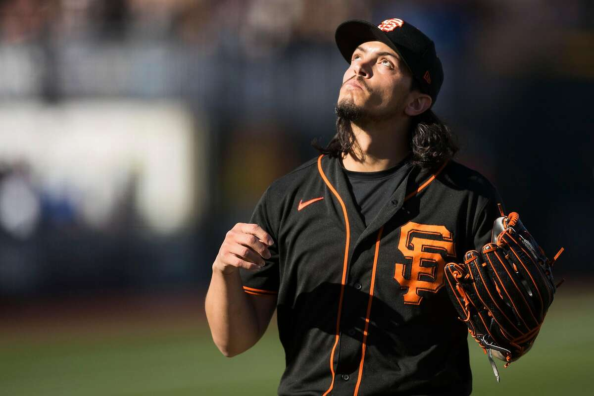 SCOTTSDALE, AZ - FEBRUARY 22: Dereck Rodriguez #57 of the San Francisco Giants reacts during the game against the Los Angeles Dodgers on Saturday, February 22, 2020 at Scottsdale Stadium in Scottsdale, Arizona. (Photo by Adam Glanzman/MLB Photos via Getty Images)