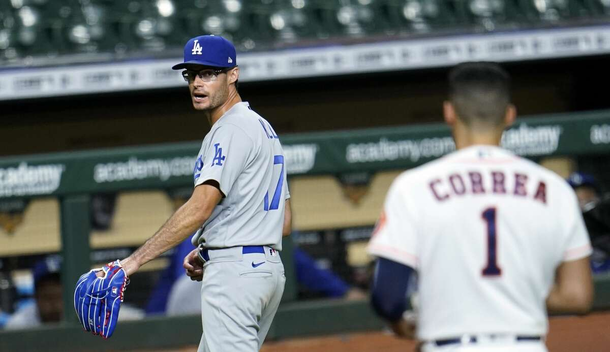 This moment - Joe Kelly going to the dugout as Carlos Correa stares him down - made the Dodgers reliever some sort of hero.