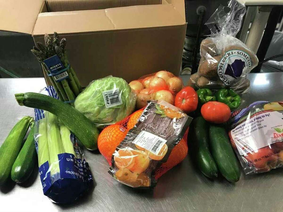 Fresh food prepared to be given out through Laker School's food distribution program. The program will continue through the upcoming school year, as school district's across Huron County plan on making changes to how students gets school meals safely. (Tribune File Photo)
