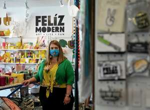 Ginger Diaz stands among the items for sale at Feliz Modern's West Olmos Drive location.