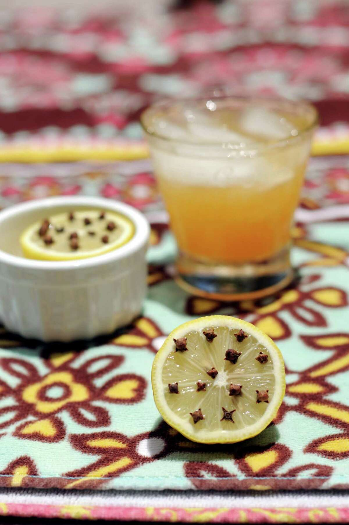 Lemon halves studded with cloves will help keep bugs away from your fruity summer beverages.