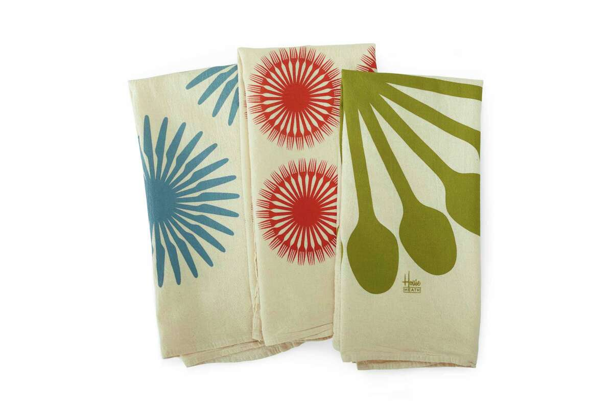 Heath Ceramics has a set of three soft, lint-free and absorbent flour sack towels, shown here, printed with hip, bold flatware graphics designed by the type foundry House Industries. Instead of a small napkin, consider using larger tea towels when outdoor dining; they make nice lap covers and hand wipes. (Heath Ceramics via AP)