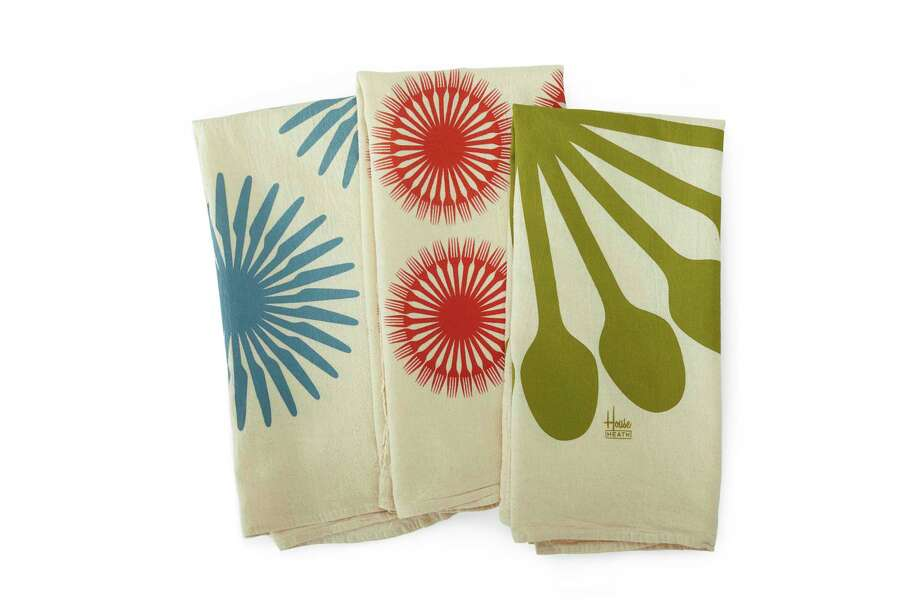 Heath Ceramics has a set of three soft, lint-free and absorbent flour sack towels, shown here, printed with hip, bold flatware graphics designed by the type foundry House Industries. Instead of a small napkin, consider using larger tea towels when outdoor dining; they make nice lap covers and hand wipes. (Heath Ceramics via AP) Photo: Associated Press / Heath Ceramics
