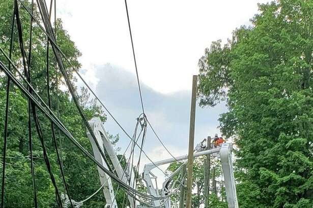 Utility trucks and crews began dealing with a rat's next of wires down near the intersection of Route 33 and 35 in Ridgefield.