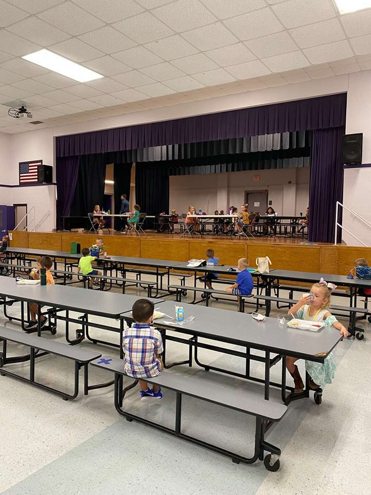 """Photos of spaced out cafeterias and masked elementary school kids were shared on Wednesday by Thrall Elementary, a campus in Thrall, which is about 30 minutes east of Round Rock. In a letter to parents, Thrall ISD Superintendent Tommy Hooker said he recognized """"that this will be an unusual school year, but we remain committed to supporting your student's learning, as well as his or her safety."""""""
