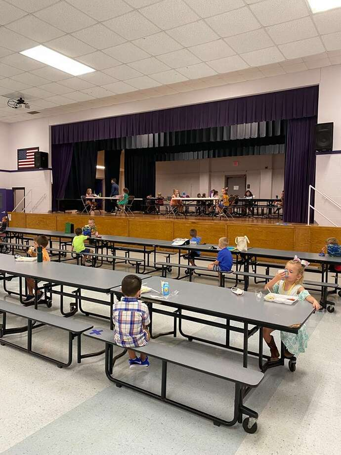"Photos of spaced out cafeterias and masked elementary school kids were shared on Wednesday by Thrall Elementary, a campus in Thrall, which is about 30 minutes east of Round Rock. In a letter to parents, Thrall ISD Superintendent Tommy Hooker said he recognized ""that this will be an unusual school year, but we remain committed to supporting your student's learning, as well as his or her safety."" Photo: Thrall Elementary School"