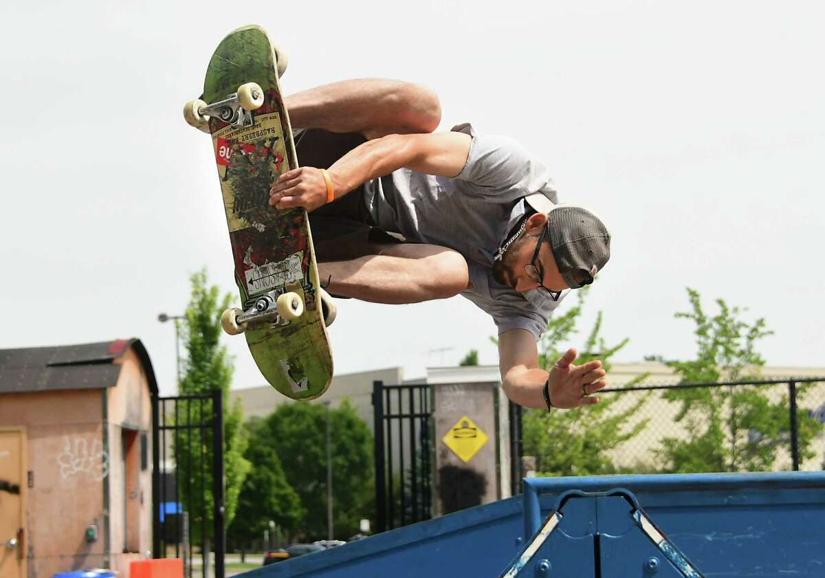 Joe Bishop of Clifton Park flips over a ramp on his skateboard at a skatepark on Thursday, Aug. 13, 2020 in Clifton Park, N.Y. (Lori Van Buren/Times Union)