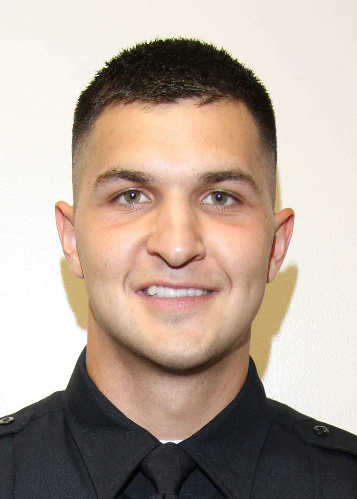Officer Thomas H. Villarreal was fired in July after police say he used excessive force in punching a suspect who had fled on foot after a traffic stop.