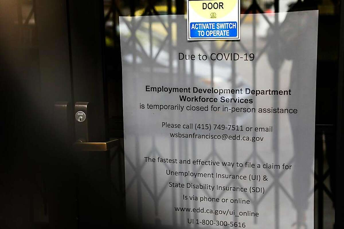 Signage on the door saying that the Employment Development Department office is closed due to Covid-19 is seen on Monday, June 15, 2020 in San Francisco, California.