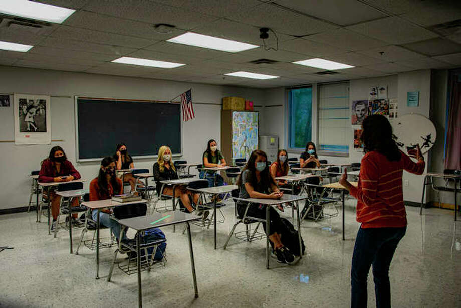 Edwardsville High School students chat with their teacher prior to the start of the first period on Thursday. Photo: Tyler Pletsch | The Intelligencer