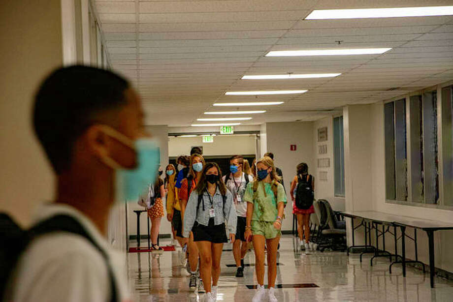Edwardsville High School students follow floor signage directing them which direction to go up and down hallways and stairwells on their first day of school Thursday morning. Photo: Tyler Pletsch | The Intelligencer