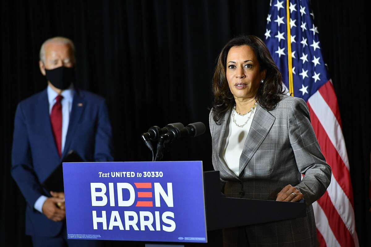 Democratic presidential nominee, former US Vice President Joe Biden (L), and vice presidential running mate, US Senator Kamala Harris, hold a press conference after receiving a briefing on COVID-19 in Wilmington, Delaware, on August 13, 2020. (Photo by MANDEL NGAN / AFP) (Photo by MANDEL NGAN/AFP via Getty Images)