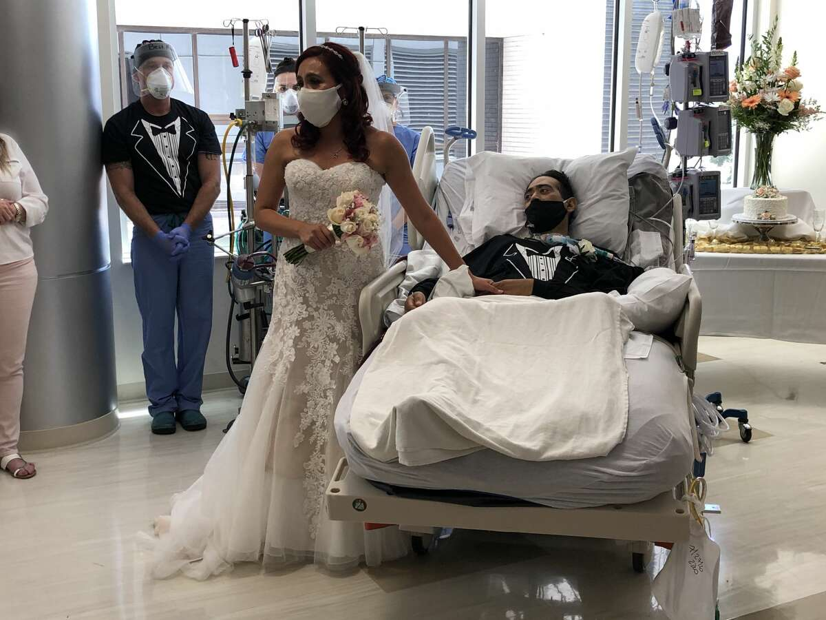 Such was the case last Tuesday as bride-to-be Grace Muniz walked into an intensive care unit at Methodist Hospital wearing her gown, veil and mask, ready for her big day with her husband Carlos Muniz. Methodist Hospital said the pair was set to wed in mid-July before Carlos became ill with the novel coronavirus. He was admitted to the telemetry unit at the hospital on July 15, but his health took a turn for the worse within days and he was transferred to ICU for emergency cannulation. Carlos was placed on ECMO, a treatment that adds oxygen to a patient's blood in order to give damaged organs time like the lungs to rest.