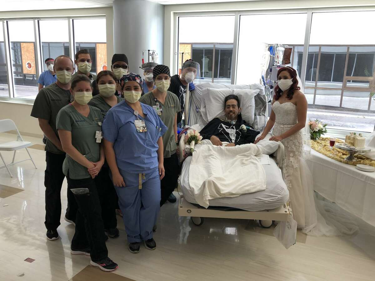 """Carlos' nurses said his """"emotions had drained from his body,"""" according to a news release. A month later, Carlos no longer has COVID-19, but remains in the ICU and on ECMO treatment. Carlos' body is still recovering from the disease, but he's a married man."""