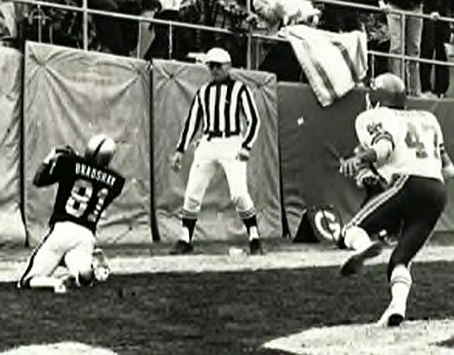 Oakland Raiders wide receiver Morris Bradshaw hauls in a touchdown pass at the back of the end zone. An Edwardsville High School graduate, Bradshaw played for the Raiders from 1974 to 1981. Photo: For The Intelligencer