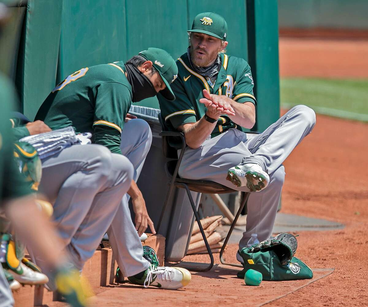 A's reliever Jake Diekman (35) chats with Joakim Soria (48) as the Oakland Athletics played in a simulated game at the Coliseum in Oakland, Calif., on Sunday, July 19, 2020.