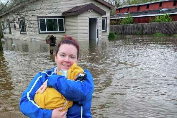 Lisa Dunlap rescues her cat from a half-flooded home in Sanford in May 2020. (Photo provided/Lisa Dunlap)