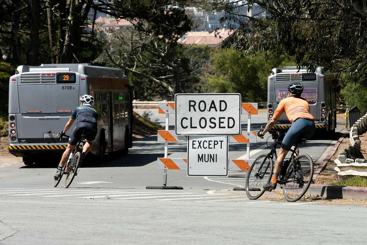 Bicyclists ride down Bowley Street, which is closed to motorists except Muni, on Thursday, Aug. 13, 2020, in San Francisco, Calif. Bowley Street leads to an access road to Baker Beach.