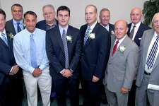 The West Haven Twilight League held their annual awards dinner in 2007. Pictured, from left to right, Thomas 'Tinker' Blake, West Haven Mayor John Picard, Sal Coppola, Edward Giannotti, Chip Malafronte, Al Carbone, George Collins, Vin DiLauro, Harry Noyes and Bob Greenwood are photographed at the 2007 West Haven Twilight League Awards banquet at the West Haven Italian American Club on 9/26/2007. Photo by Arnold Gold AG0229F