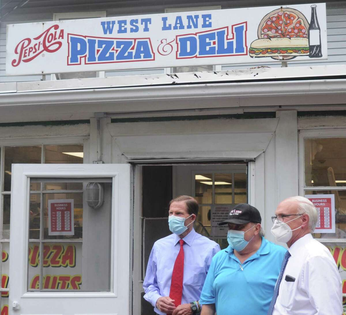 U.S. Senator Richard Blumenthal, West Lane Pizza and Deli owner Kosta Efstathiades and First Selectman Rudy Marconi on Wednesday at the deli, which lost inventory and a week of business due to delays in power restoration.