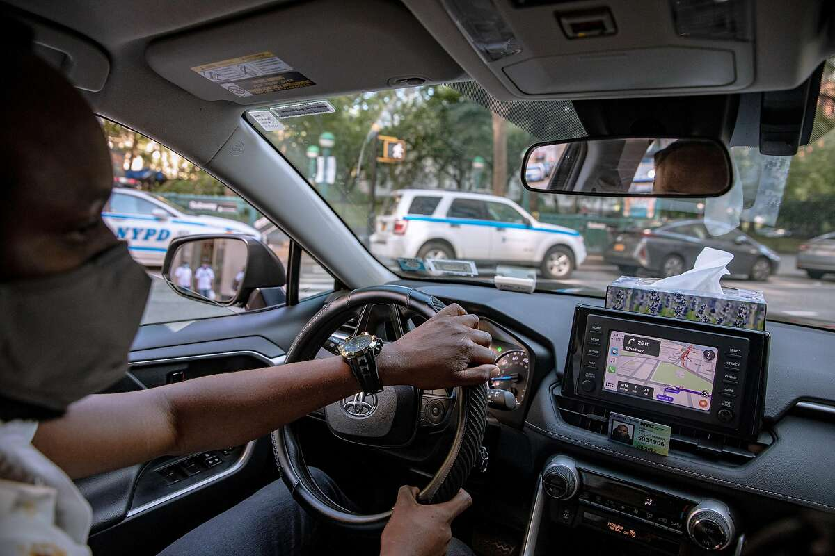 Uber driver Thankgod Amedu drives his car in New York, July 13, 2020. Drivers for Uber and Lyft won a key victory in their yearslong campaign to secure traditional unemployment insurance on July 28 when a federal judge in New York ruled that the state must promptly begin paying them benefits.
