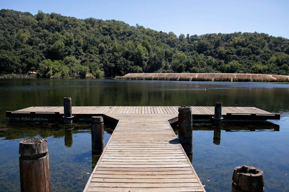 A dock extends into Boronda Lake at Foothills Park in Los Altos Hills, Calif. Tuesday, August 11, 2020. Since it opened in 1965, Foothills Park has been restricted to residents, a practice some residents consider discriminatory. The city council finally made some concessions, allowing up to 50 non-residents a day, but activists say it's not enough.