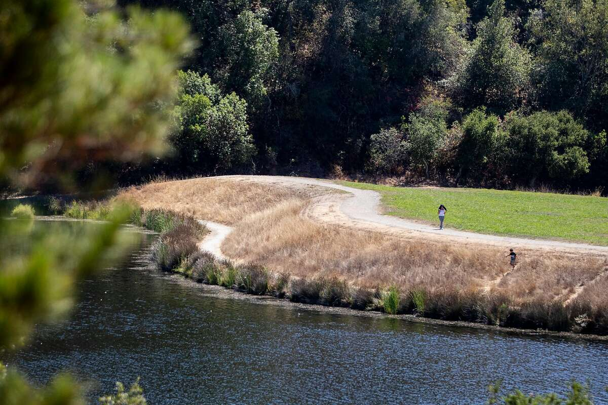 Pedestrians walk around Boronda Lake at Foothills Park in Los Altos Hills, Calif. Tuesday, August 11, 2020. Since it opened in 1965, Foothills Park has been restricted to residents, a practice some residents consider discriminatory. The city council finally made some concessions, allowing up to 50 non-residents a day, but activists say it's not enough.