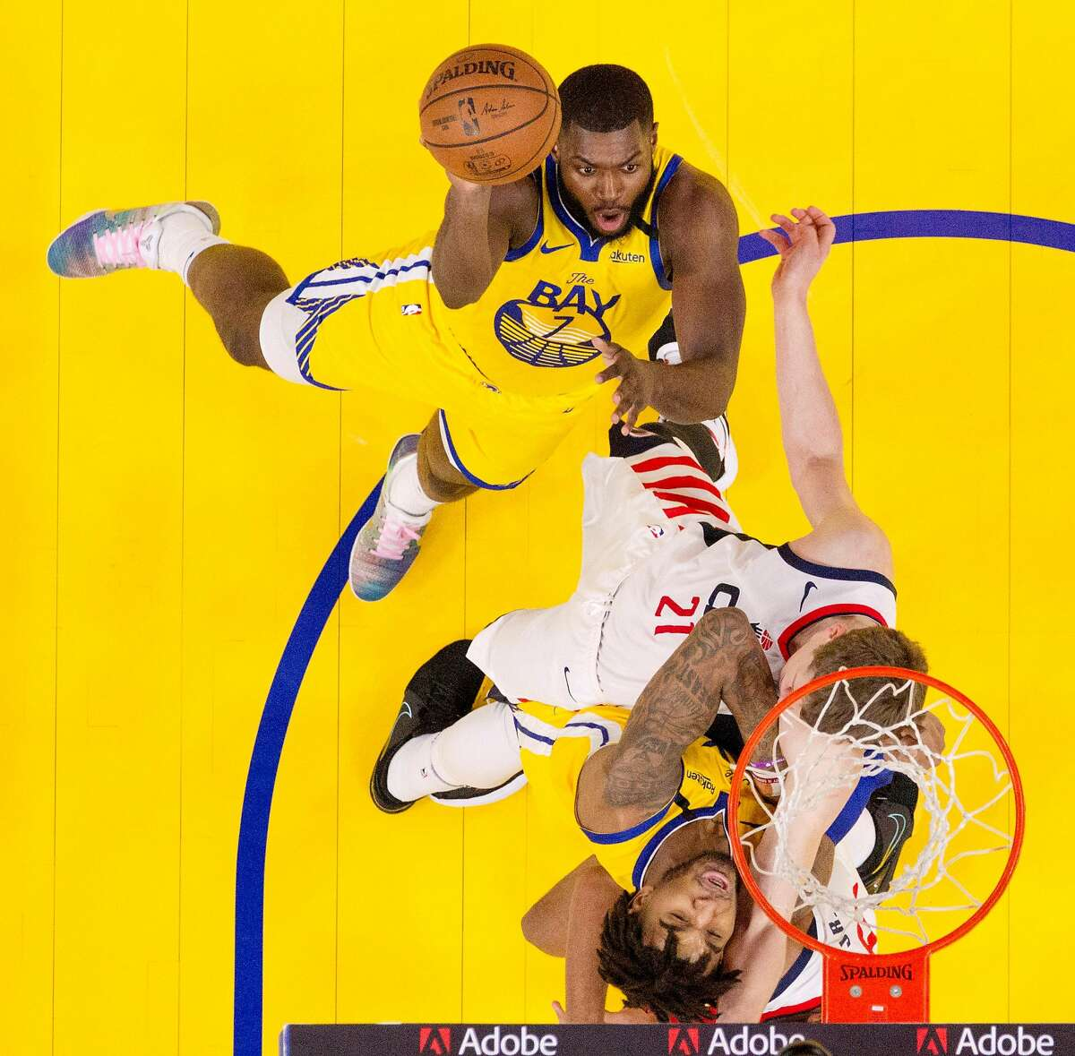 Eric Paschall (7) shoots in front of Moritz Wagner (21) in the first half as the Golden State Warriors played the Washington Wizards at Chase Center in San Francisco, Calif., on Sunday, March 1, 2020.