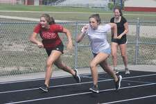 The Manistee girls swimming team made the most of their practice time outside the pool.