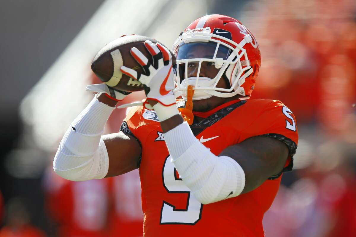 STILLWATER, OK - OCTOBER 19: Cornerback Kemah Siverand #5 of the Oklahoma State Cowboys catches a pass before a game against the Baylor University Bears on October 19, 2019 at Boone Pickens Stadium in Stillwater, Oklahoma. Baylor's record was 7-0 after the 45-27 road win. (Photo by Brian Bahr/Getty Images)
