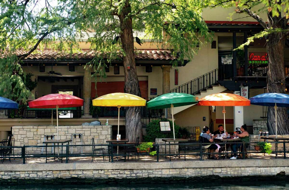 People enjoy lunch at Casa Rio restaurant the River Walk on Aug. 13. There are many empty tables these days, to accommodate social distancing guidelines and because tourists have not been coming to the city during the pandemic. The lack of revenue is forcing the city to rethink its budget and has Mayor Ron Nirenberg calling for redirecting a 1/8-cent sales tax that now goes to buy land to protect the Edwards Aquifer to instead be spent on an economic recovery plan that includes worker training, which could lead to access to better health services.