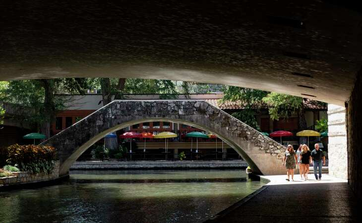 The River Walk, which usually is crowded with tourists during August, is being visited by far fewer people because of the coronavirus pandemic.
