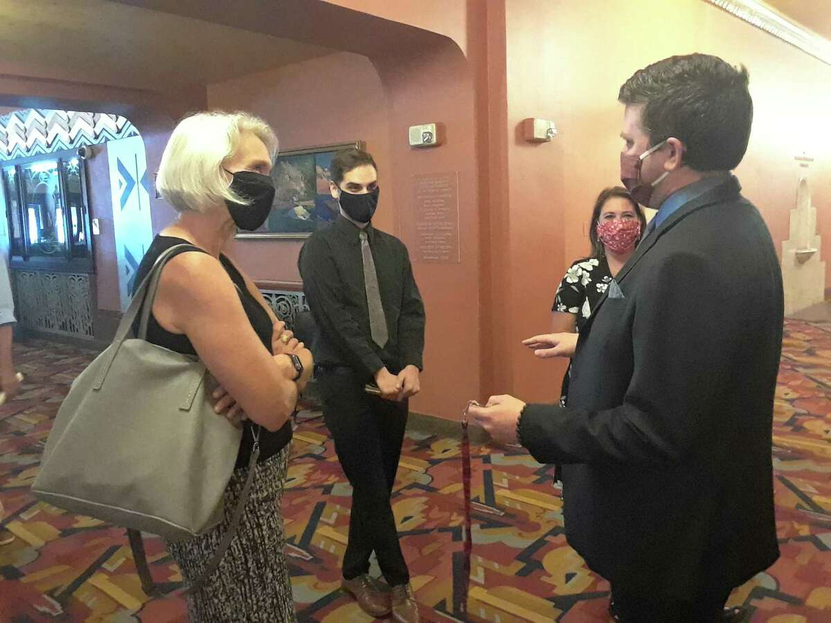Warner Theatre Executive Director Rufus DeRham right, talks with state Rep. Maria Horn, left, Thursday at the theater.