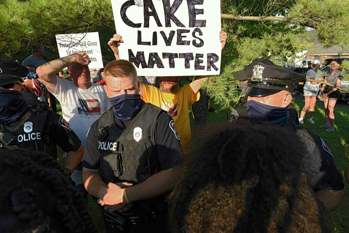 Clashes between protesters and counter protesters occurred in front of Coccadott's Bakery after it posted on social media an image of a MAGA hat cake on Thursday, Aug. 13, 2020 in Albany, N.Y. (Lori Van Buren/Times Union)