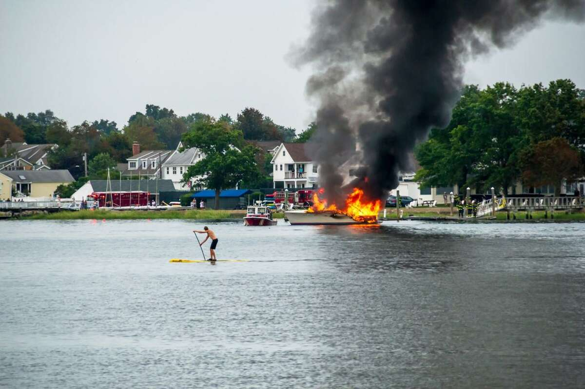 A boat burns off Shore & Country club in Norwalk, Conn. Thursday Aug. 13 2020.