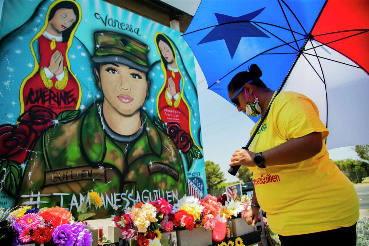 Amanda Gonzales stands in front of the memorial mural of Army Spec. Vanessa Guillén on Friday, July 17, 2020, in Fort Hood. Gonzales has been visiting the mural of Army Spec. Vanessa Guillén everyday keeping clean and organized.