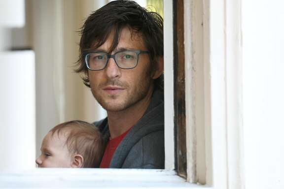 Matt Brezina with his 11 week old son Makai at home on Thursday, Aug. 13, 2020, in San Francisco, Calif.