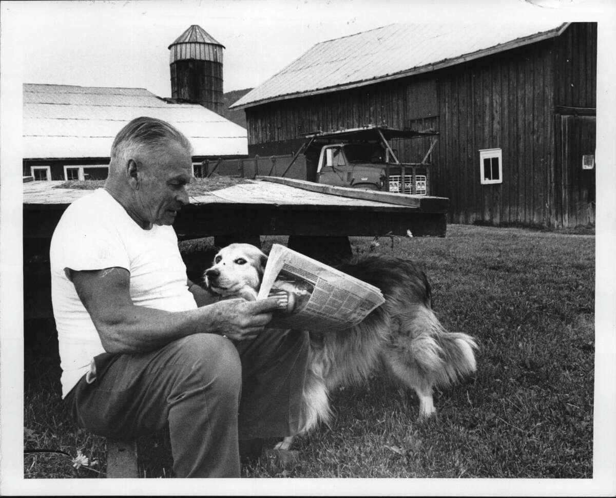 Potter Hollow, New York - John Makley, farmer, and dog, Lassie. Farm has been in family for 175 years. August 14, 1980 (Bud Hewig/Times Union Archive)