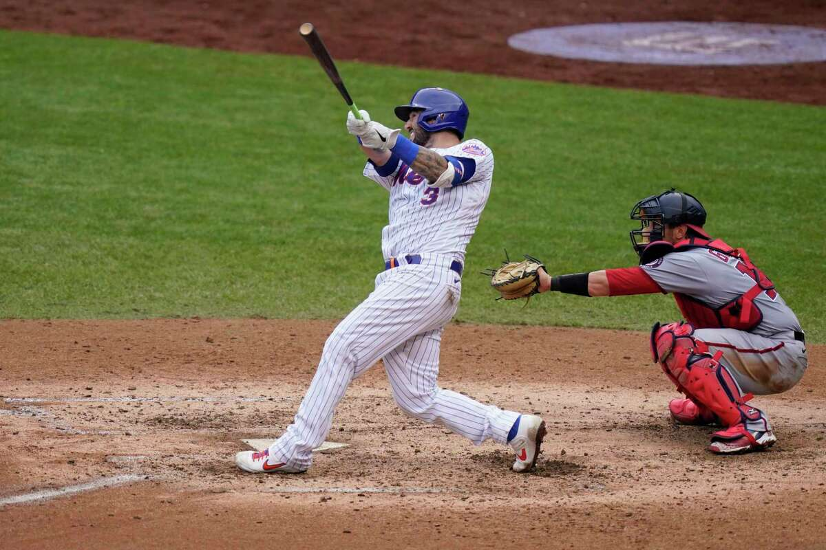 New York Mets' TomA!s Nido hits a grand slam home run during the fifth inning of a baseball game against the Washington Nationals at Citi Field, Thursday, Aug. 13, 2020, in New York. (AP Photo/Seth Wenig)