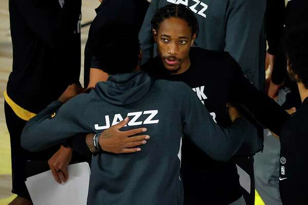 LAKE BUENA VISTA, FLORIDA - AUGUST 13: Donovan Mitchell #45 of the Utah Jazz and DeMar DeRozan #10 of the San Antonio Spurs congratulate each other after the game at The Field House at ESPN Wide World Of Sports Complex on August 13, 2020 in Lake Buena Vista, Florida. NOTE TO USER: User expressly acknowledges and agrees that, by downloading and or using this photograph, User is consenting to the terms and conditions of the Getty Images License Agreement. (Photo by Kevin C. Cox/Getty Images)