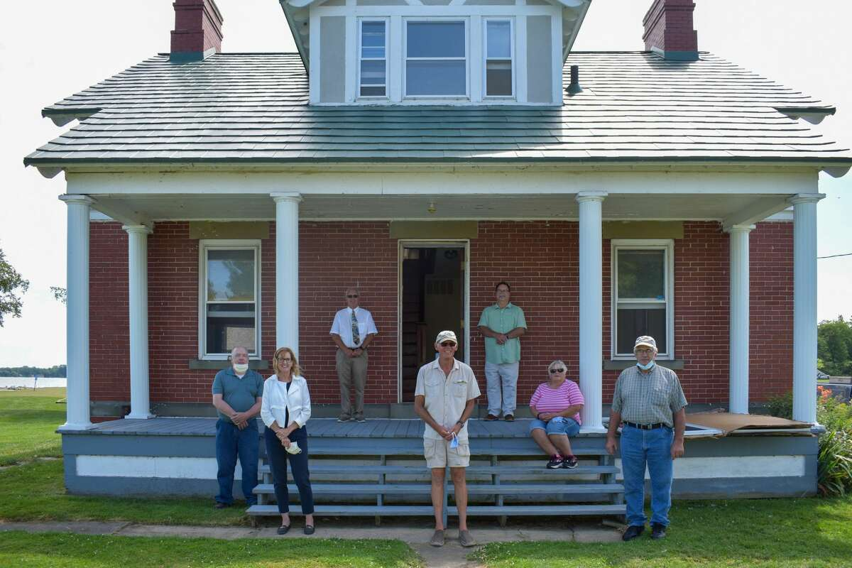 From left to right: Habitat for Humanity representatives Ed Watteny and Carolyn Nestor, Vice Chairman of the Huron County Road Commission Allan McTaggart, President of the Pointe aux Barques Lighthouse Society Larry Becker, Habitat for Humanity board member Terry Brown, and Lighthouse Society board members Marolyn Becker and Jim Iceler.
