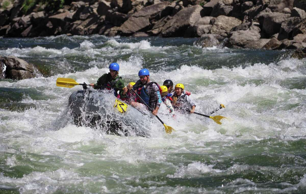 Billy Kurtz and his family paddle through a rapid dubbed the Zoom Flume in Browns Canyon on the Arkansas River in Colorado.