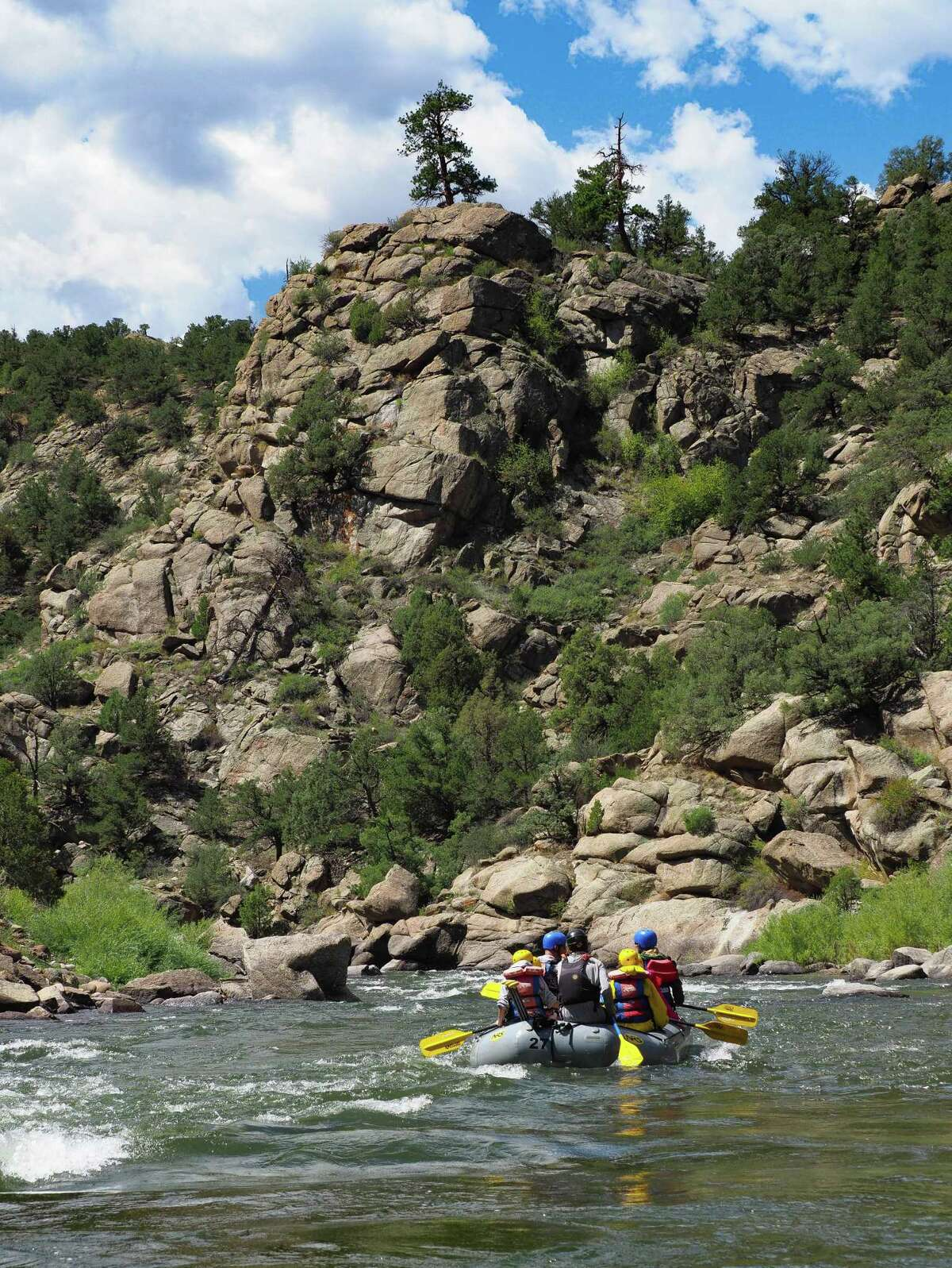 Rafts glide through Browns Canyon on the Arkansas River in Colorado.
